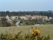 Village, seen from a distance across a field