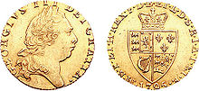 A gold coin with a man's head on one side and a crowned heraldic shield on the other
