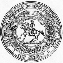"Circular seal with the motto: ""The Southern Historical Society, Organized May 1, 1869; Deo Vindice"" The central device is a man on a horse, with the text ""Re-organized Aug.15.1873."", surrounded by a wreath of assorted plants."