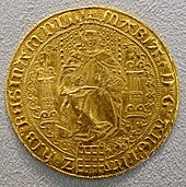 Gold coin of medieval vintage showing a woman seated on a throne