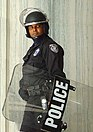 Police officer with riot shield