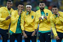 b738fb12fa Brazil players with their gold medals from the 2016 Summer Olympics
