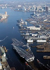 The nuclear-powered aircraft carrier USS Harry S. Truman (CVN-75) transits the Elizabeth River at Norfolk Naval Shipyard.