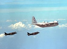 Harriers flying behind a tanker aircraft