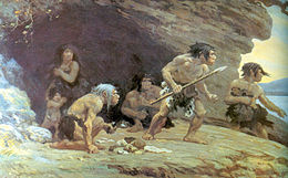 A group of 4 Neanderthal men, 1 woman, and her naked son standing on a rock platform with a cave behind them, looking worriedly off to the right. The men are wearing only furs wrapped around their waist, one has a spear, and another is crouching with food in his hand. The woman is standing inside the cave, has a fur pulled up to her collarbone, and is holding her son close