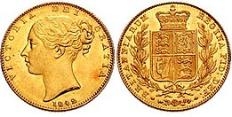 Gold coin with a woman's head on one side and a heraldic shield within a wreath on the other