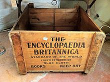 "A wooden crate reading ""THE / ENCYCLOPAEDIA / BRITANNICA / STANDARD OF THE WORLD / FOURTEENTH EDITION / BLUE CLOTH / BOOKS KEEP DRY"""