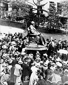 Unveiling of the bronze Darwin Statue outside the former Shrewsbury School building in 1897 surrounded by schoolboys in straw hats