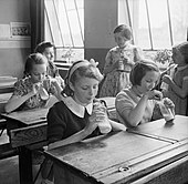 Girls photographed at Baldock County Council School in Hertfordshire enjoy a drink of milk during a break in the school day in 1944.